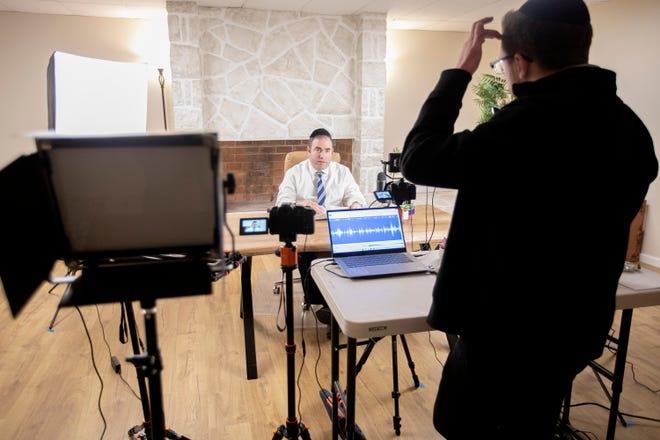 Rabbi Avi Goldstein, left, senior rabbi at Beth Jacob Congregation, and Rabbi Chaim Davies, right, record in the congregation's new recording studio on Tuesday, combining ancient Torah readings with new technology. A Pew Research Center study shows that 17% of Jews under 30 identify as Orthodox or ultra-Orthodox, compared to 3 percent of those 65 and older.