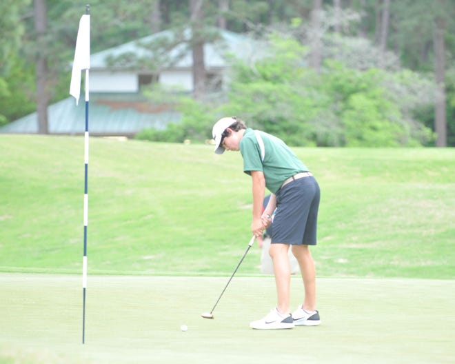 Eastern Randolph's Connor Carter putts at Pinehurst No. 6 on Monday. [Mike Duprez/Courier-Tribune]
