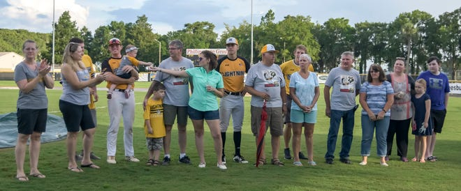 Leesburg Lightning players and their host families gather on the field before a game in 2019 at Pat Thomas Stadium-Buddy Lowe Field in Leesburg. The Lightning is looking for host families to house six more players for the upcoming season, according to the team's host familiy coordinator. [PAUL RYAN / CORRESPONDENT]