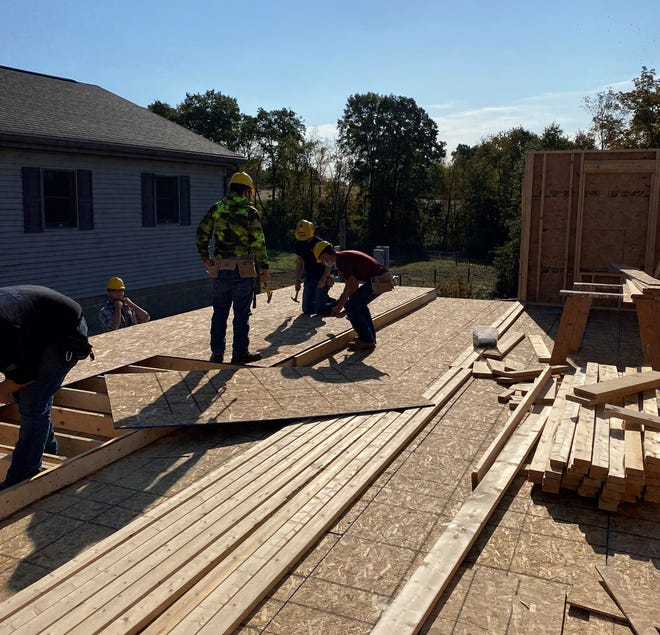Mid-East Career & Technology Centers students gain hands-on experience for a booming construction field by building a house for Habitat for Humanity at the Buffalo campus in Guernsey County. The demand for construction workers is on the rise, according to industry officials.