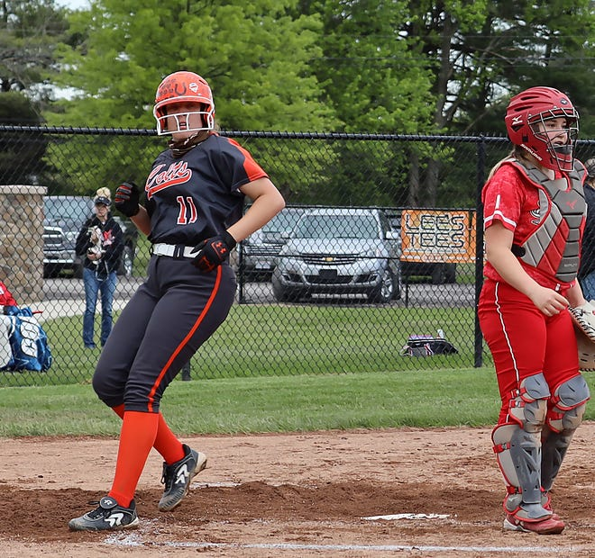 Meadowbrook senior Lynsey Dudley (11) crosses the plate after scoring a run during Monday's 11-2 victory over Beaver Local in Division II sectional softball tournament action in Byesville.