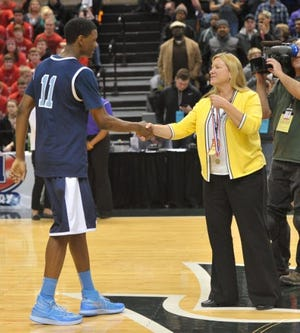 Madison schools Athletic Director Kris Isom, right, congratulates then-sophomore Josh Jackson of Voyageur College Preparatory High School in Detroit during the 2014 MHSAA boys basketball state championship games played in East Lansing.