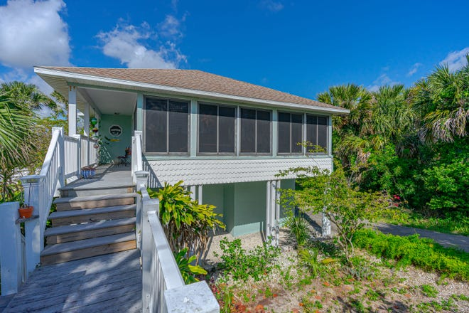 Nestled in Wilbur-by-the Sea, one of Florida's most sought-after seaside neighborhoods, this wonderful home has an enormous garage space on the first level that has room for four cars and an additional unfinished room that could be used for more living space.