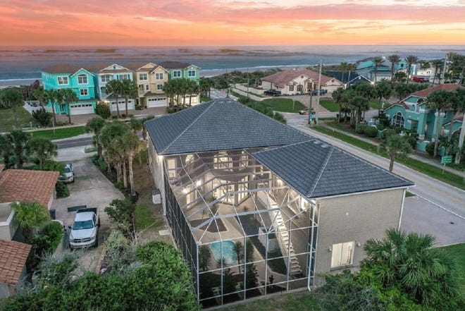 This Ponce Inlet brick beauty sits on a corner lot, just steps from the ocean.
