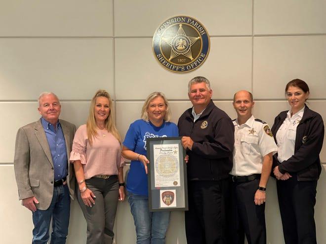 Col. Paul Robert, Belinda Eliser, Cindy Peno, Sheriff Bobby Webre, Lt. Col. Cody Melancon, and Lt. Col. Laura Gremillion.