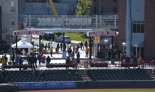 Fans enter UPMC Park on Tuesday for the Erie SeaWolves home opener against the Akron RubberDucks.
