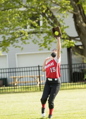 Canisteo-Greenwood's Bailey Carbone grabs a fly ball in right field during Monday's contest with Avoca/Prattsburgh in Canisteo.