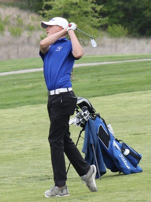 Grain Valley golfer Charlie Aldred hits an approach shot on the ninth hole during the Class 4 District 4 tournament Monday at the Paradise Pointe Golf Complex's par-72 Posse course. Aldred fired an 85 to earn a state berth along with teammate Owen Herbert, who shot 84.
