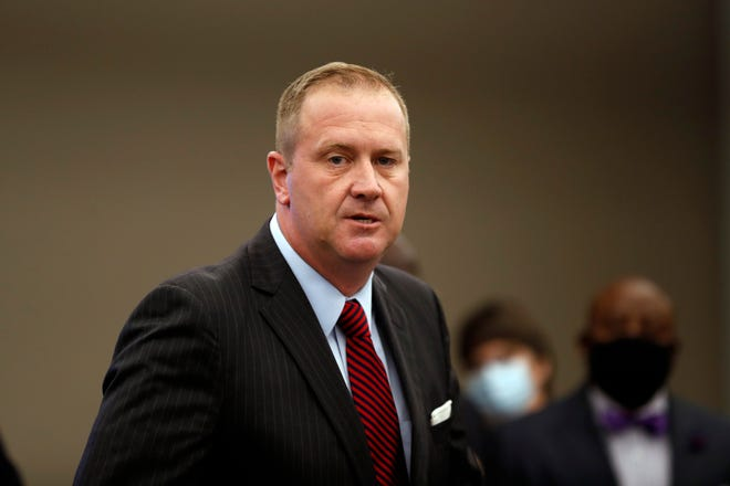 Missouri Attorney General Eric Schmitt speaks during a news conference in St. Louis in August. Attorney General Schmitt filed a lawsuit on Tuesday over St. Louis County's COVID-19 restrictions. The lawsuit says the county's restrictions are too severe and asks the court to end them.