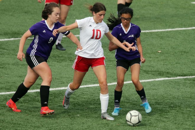 Fort Madison High School's Claire Pothitakis (10) is flanked by Burlington High School players Kaitlyn Weinreich (9) and Myah Rehman (1) during their game Tuesday May 11, 2021 at Burlington's Bracewell Stadium.