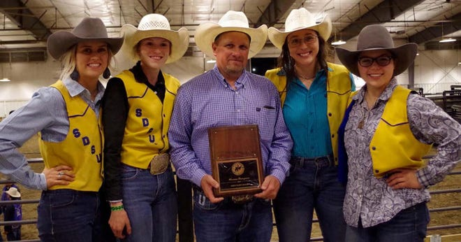 The women's SDSU Rodeo Team has earned the title of 2020-21 Great Plains Region Champions. From left to right, members of the team include Allison Pauley, Tori Jacobs, coach Ron Skovly, Jacey Hupp and Shelby Spanel.