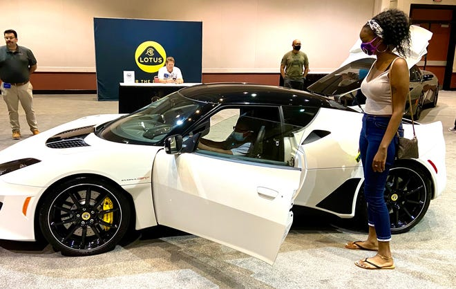 This youngster enjoys the opportunity to sit behind the wheel of a 2021 Lotus Ever GT — one of five brought to the Jacksonville International Auto Show last weekend by World Imports USA and Lotus of Jacksonville.