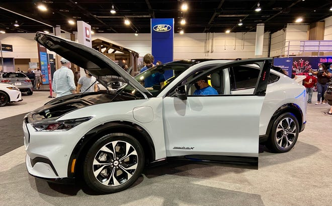 Kurt Browning and son Beau, from Brunswick, Georgia, check out the interior of the all-new and all-electric 2021 Mustang Mach-E SUV.