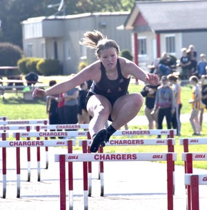 Orion's Lily Laws races in the 100-meter hurdles on Wednesday, May 5, when the Chargers hosted the Riverdale Rams in Orion. Laws finished second in 19.26 seconds.