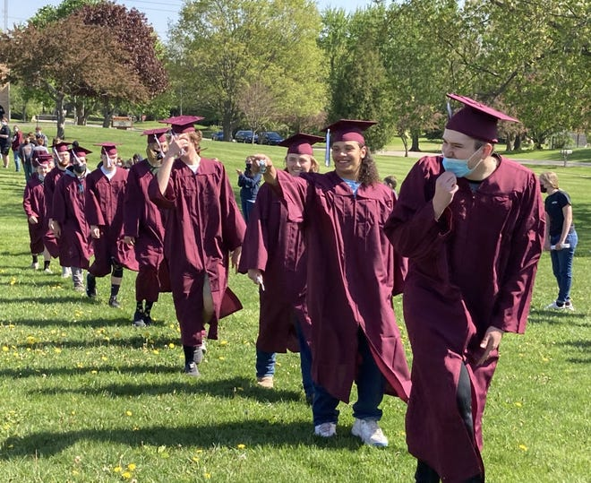After graduation practice on Friday morning, May 7, Cambridge seniors donned caps and gowns to walk between lines of students from the high school to Cambridge Elementary School. The walk encourages younger students to stay in school and work hard to graduate.