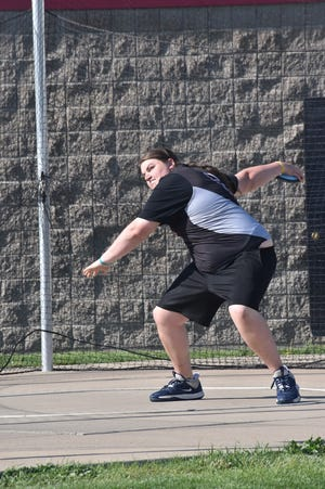 Shaw Ringier of Orion flings the discus during the dual with Riverdale on Wednesday, May 5, at Charger Field. Ringier's best throw was 25.13 meters (82 feet, 5 inches)