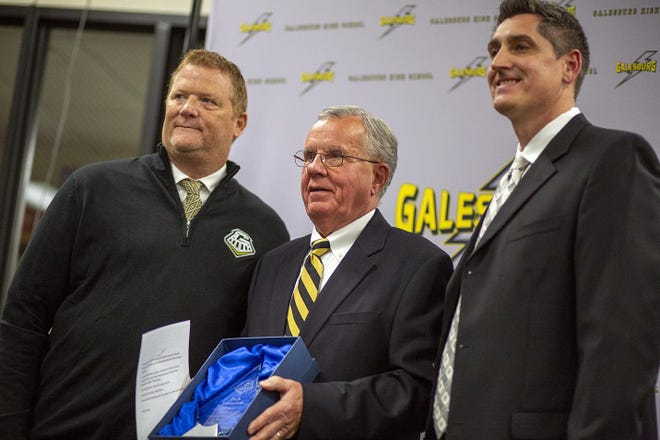 From left, Galesburg High School Principal Jeff Houston, Dick Lindstrom, and GHS AD Eric Matthews appear at the 2019 Hall of Fame induction ceremony.