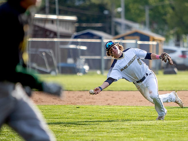 Knoxville third baseman Beau Honeycutt makes an off-balance throw for an out during the Blue Bullets' 12-2, six inning win over Abingdon-Avon on Monday, May 10, 2021 at Billy Notz Memorial Field.