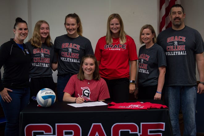 Laney Clark is joined by her family, Grace College volleyball, and her Pittsford Head Coach during her national signing day.