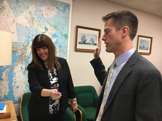 Corporation Counsel Alan Rumsey is sworn in by City Clerk Allison Bouchard in this Jan. 6, 2020, file photo.
