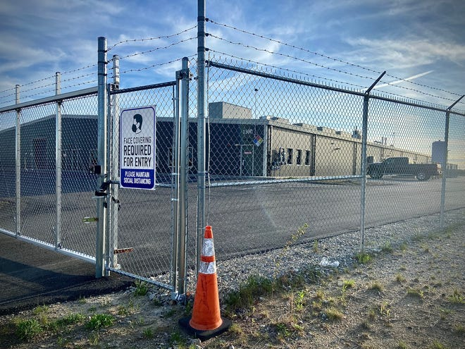 What has been described as a Health For Life marijuana cultivation facility on Innovation Way has yet to open and is fenced off behind barbed wire.