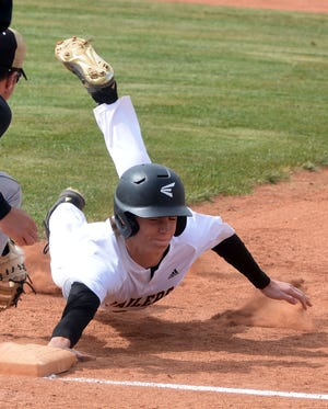 Newton junior Drew Barron dives back to base to avoid a pickoff attempt during play Monday at Klein-Scott Field. Newton opens regional play next week.