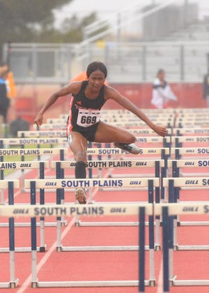 South Plains College's Joniar Thomas competes in the heptathlon 100-meter hurdles during Tuesday's first day of the NJCAA track and field championships in Levelland. Later in the day, the freshman from Grenada won the women's long jump.