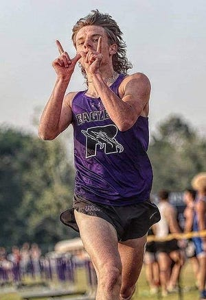 Johnny Lindsey, seen here crossing the finishing line at the district meet, scored in both the 3200-meter relay and the 800-meter run for Rosepine at the Class 2A state meet last Friday.