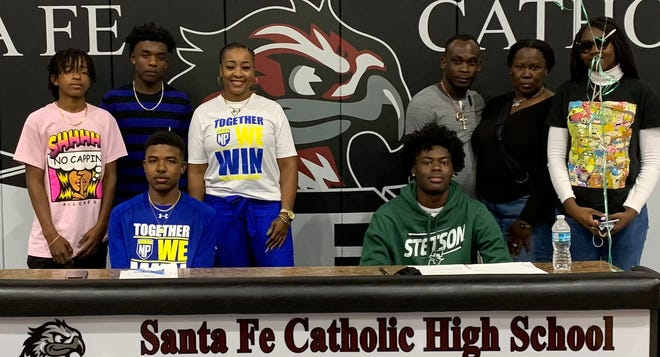 Johnny Torrence, signing with North Park University (D3 in Chicago) to play basketball, with Mom Danni Faye Burton and his two brothers.  Alvin Tumblin, signing with Stetson University to play basketball, with Mom Ophelia Slappey, her husband and his sister.