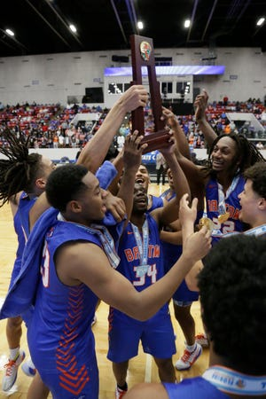 Bartow celebrates with the state championship trophy after winning its second state title in a row in March.