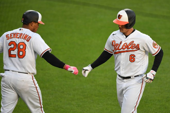 Baltimore Orioles' Ryan Mountcastle (right) celebrates his first-inning home run with Pedro Severino during a baseball game against the Boston Red Sox on Monday in Baltimore.