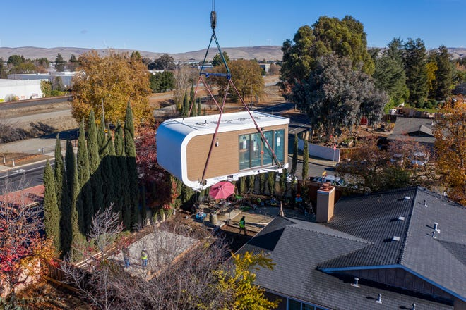 A 3D-printed housing module gets delivered in Livermore, California. [Courtesy of Mighty Buildings via AP]