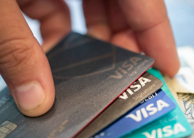 Visa credit cards are pictured in New Orleans. [AP File Photo/Jenny Kane]
