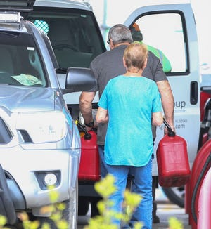 A man filled multiple gas cans at the  Murphy Express at Beal Parkway and Racetrack Road as gas lines started popping up at numerous gas stations around the Fort Walton Beach area..