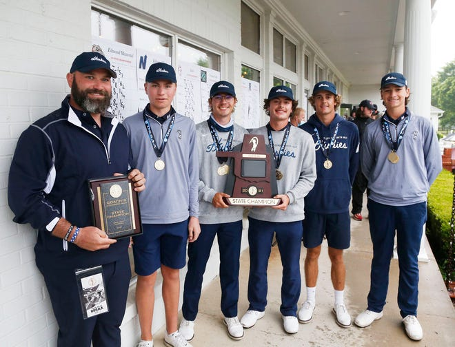 Edmond North poses with the Class 6A boys golf state trophy after winning the rain-shortened event Tuesday at Forest Ridge in Broken Arrow.