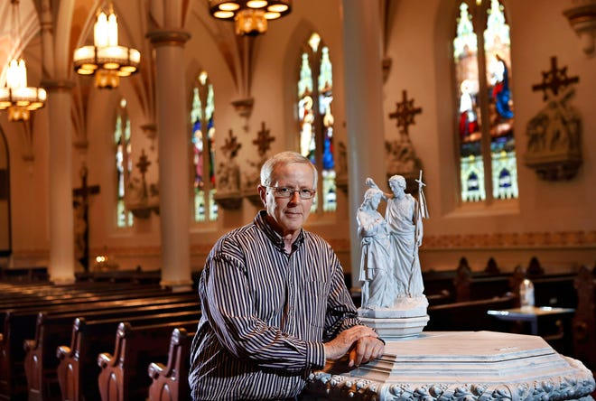 Father Joe Ross, seen here at St. Joseph's Old Cathedral in downtown Oklahoma City in 2012, was an altar server in 1957 when the Notre Dame football team celebrated mass at Holy Name Catholic Church in Chickasha. The Fighting Irish went on to beat OU that day, and Ross went on to be a Catholic priest for decades in Oklahoma. He died last week.