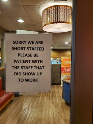 Restaurants throughout the metro area are warning customers of longer waits due to staffing shortages.