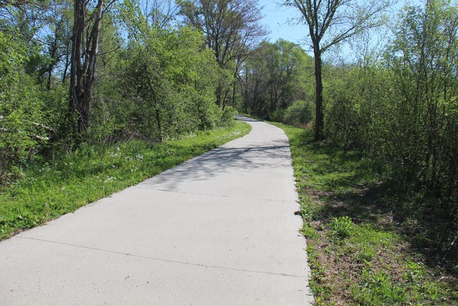 A portion of the initial 1.5-mile paved path that runs east from Perry. Work will start on Phase III and IV of the Let's Connect Trail Project this summer.