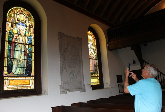 Ray Williamson of Prince George takes photos of priceless works of art inside Blandford Church in Petersburg on July 6, 2019.