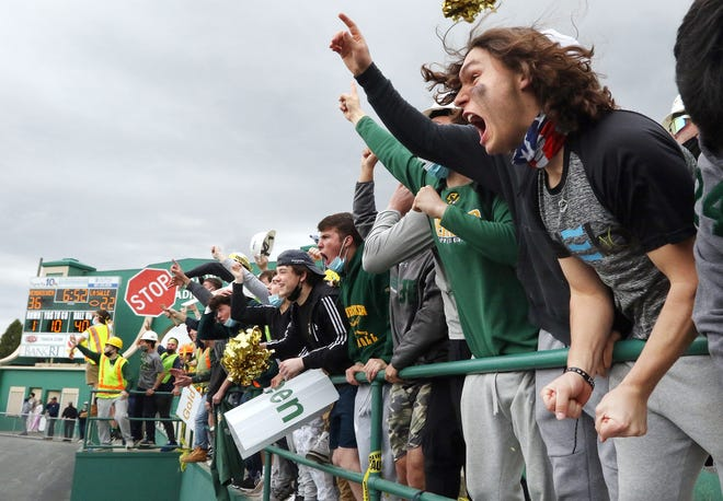 Bishop Hendricken High School students erupt after their Hawks pull away from the La Salle Academy Rams, 36-22, in the coronavirus pandemic-delayed Power Four Super Bowl, played May 8. Their joy was enduring: Hendricken won 43-22.
