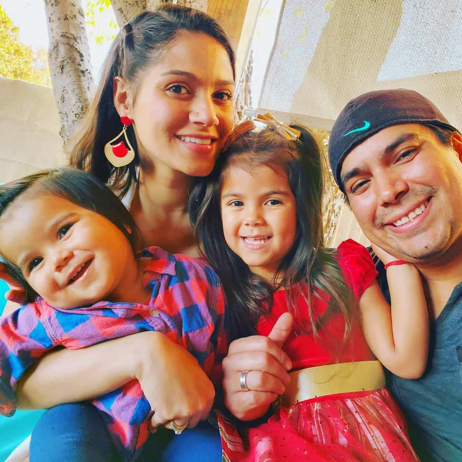 Dayana Costa and her husband, Angelo Fuentes, with their children, Thiago and Barbara.
