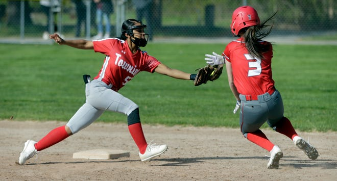 Janett Sosa (left, in action from last week) and the East Providence softball team picked up their first win of the season Tuesday afternoon.