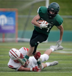 Ponaganset's Nick Baccala, shown in last spring's Division IV Super Bowl, ran for more than 200 yards and scored three touchdowns. Was it enough to earn the No. 1 spot in The Providence Journal's Top 5 Performers of the Weekend?