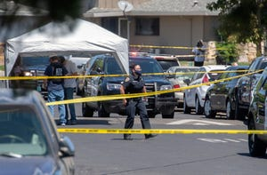 Stockton police investigate the scene of a shooting on La Cresta Way in Stockton on May 11 that claimed the life of Stockton police Officer Jimmy Inn and assailant Lance Lowe.