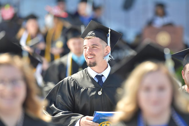 A new Kent State graduate smiles during Spring 2019 Commencement.