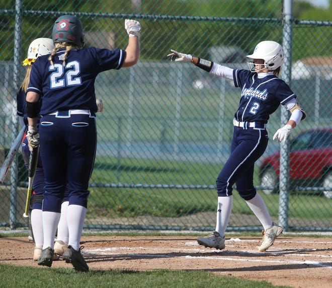 Louisville's Kaylee Nolte celebrates with teammates as she comes across the plate to score in the second inning of Monday's Division I sectional semifinal game against McKinley.