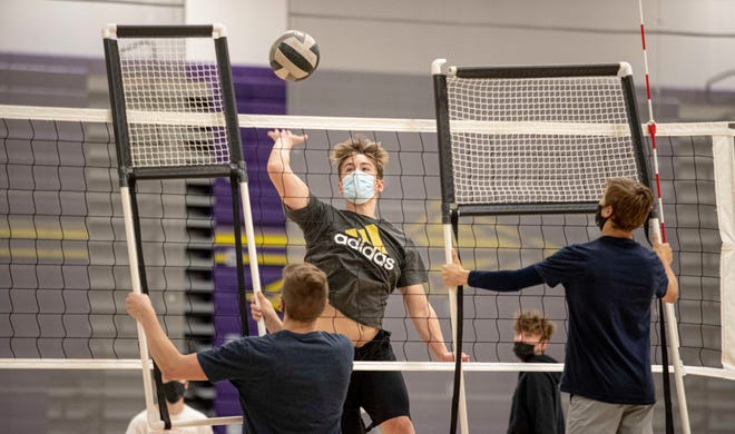 Jackson Jaegar goes up for a spike Monday during Hononegah volleyball practice. Hononegah is favored to win the NIC-10 for the first time this year and usually gets 50 players to try out for the state's fastest-growing sport.