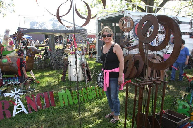 In this file photo, a shopper is all smiles and ready to take new items home from The Pec Thing at the Winnebago County Fairgrounds on May 16, 2015, in Pecatonica.