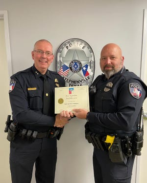 Stephenville Police Officer Warren Hartley, right, recently received his Texas Commission on Law Enforcement Instructor Certification allowing him to teach other officers across the state. Here he receives a certificate from SPD Chief Dan Harris.
