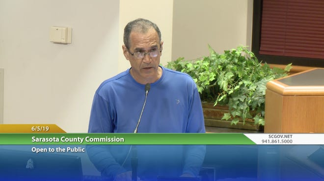Eddie Lima testifies before the Sarasota County Commission on June 5, 2019, about allegedly bad behavior by code enforcement officer Harvey Ayers.